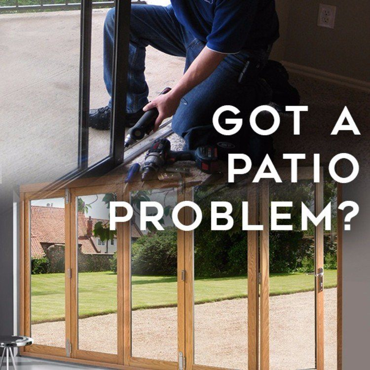 technician repairing a patio door